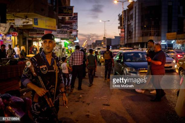 Security forces patrol outside the busy Prophet Younis market in East Mosul on November 5 2017 in Mosul Iraq Five months after Mosul Iraq's...
