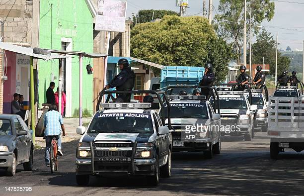 Security forces patrol rural areas close to the historic town of Tlaxcala 200 km east of Mexico City on National Election Day on July 1 2012 Polls...