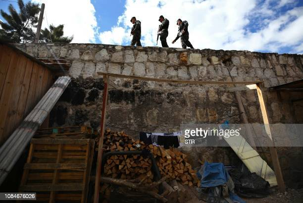 Security forces patrol the streets of Tegucigalpa on January 18 2019 as part of a new operation against gangs in cities and rural areas across...