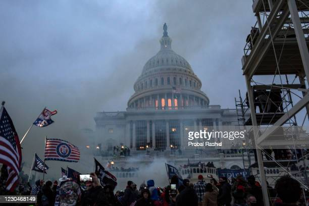 Security forces respond with tear gas after the US President Donald Trump's supporters breached the US Capitol security. Pro-Trump rioters stormed...