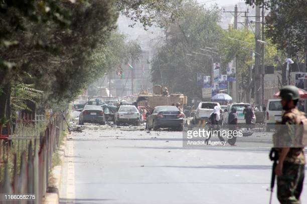 Security forces stand guard after a massive suicide car bombing rocked Afghan capital Kabul's diplomatic enclave which killed 10 people and left 30...