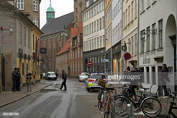 Security forces stand guard around Jewish synagogue located a few hundred meters from the Nørreport Station on February 15 2015 after one person was...