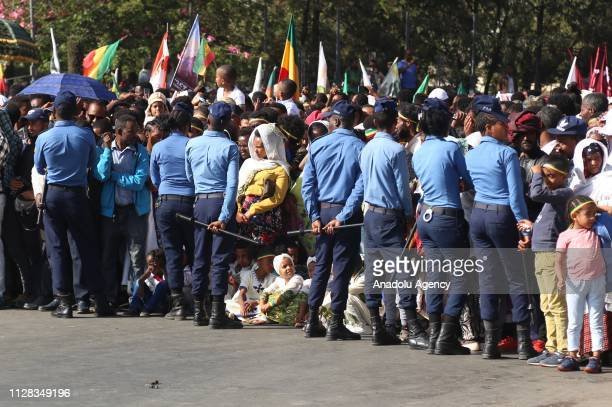 Security forces stand guard as Ethiopians attend a parade to mark the 123rd anniversary of the battle of Adwa in which Ethiopia inflicted a crushing...