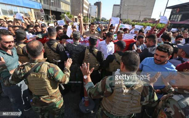 Security forces stand guard as Iraqi Kurds take part in a demonstration outside the US consulate in Arbil the capital of autonomous Iraqi Kurdistan...