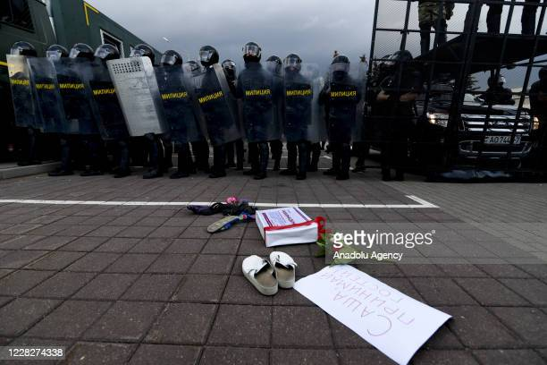 Security forces stand guard as people continue to protest over the presidential election as they march to the Stella Square in the capital Minsk,...