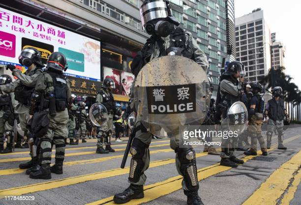 Security forces stand guard as protesters take part in an anti-government protest in Tsim Sha Tsui, Hong Kong on October 27, 2019. Hong Kong was...