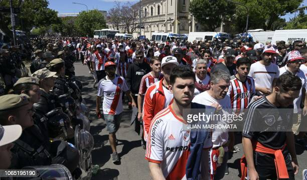 Security forces stand guard as River Plate's supporters leave the Monumental stadium in Buenos Aires after the allArgentine Copa Libertadores second...