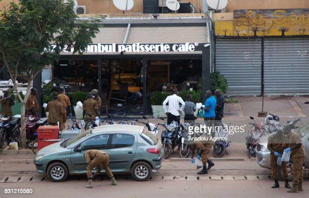 Security forces stand guard as they take security measures as some people abducted after a terrorist gunmen attack at a restaurant on Kwame Nkrumah...