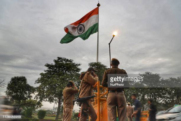 Security forces stand Guard at a Checkpoint with Indian Flag in the backdrop in New Delhi, India, on 3 March 2019.
