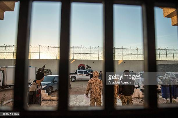 Security forces stand guard at the Milita prison where prisoners of war war kept is seen in the Libyan town of Zliten on March 4 2015