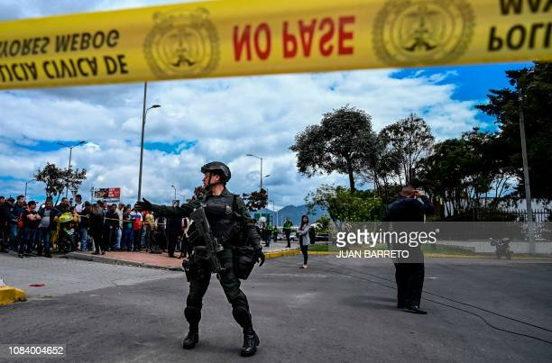 TOPSHOT Security forces stand guard at the site of an explosion at a police academy in Bogota on January 17 2019 Nine people were killed Thursday and...