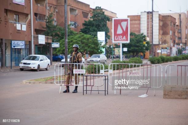 Security forces stand guard in front of a barrier as they take security measures after a terrorist gunmen attack at a restaurant on Kwame Nkrumah...