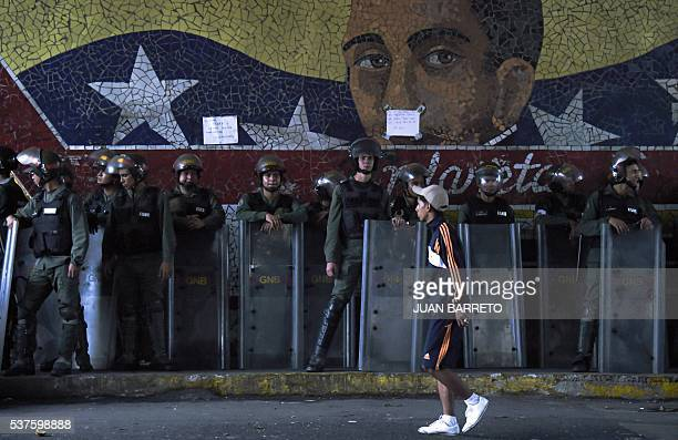 Security forces stand guard near Miraflores presidential palace where people protest against the severe food and medicine shortages in Caracas on...