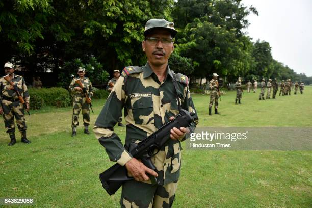 Security forces stand guard outside the Embassy of Myanmar as Social Democratic Party of India tried to march and protest against the Genocide of...