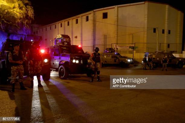 Security forces stand guard outside the Israeli embassy in the residential Rabiyeh neighbourhood of the Jordanian capital Amman following an...