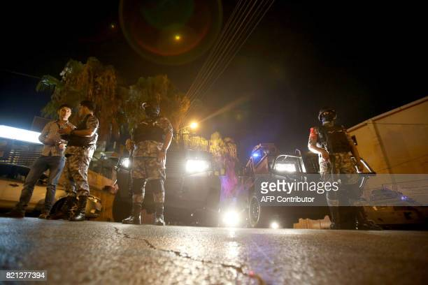 TOPSHOT Security forces stand guard outside the Israeli embassy in the residential Rabiyeh neighbourhood of the Jordanian capital Amman following an...