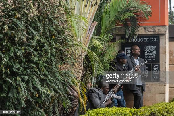 Security forces take cover outside Dusit Hotel on January 15 2018 in Nairobi Kenya A current security operation is underway after terrorists attacked...
