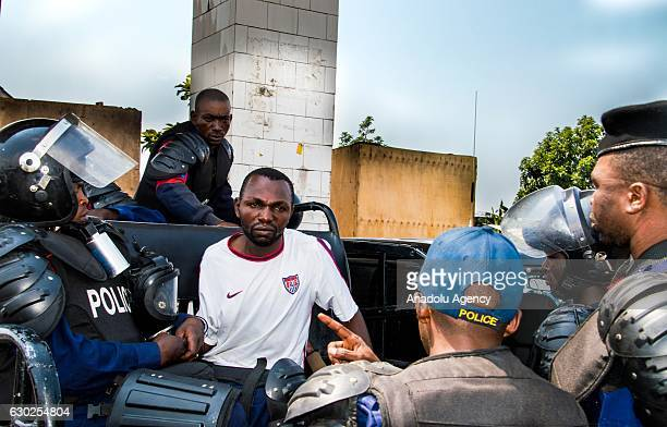 Security forces take into custody a protester as they take security measures just in case people stage a protest after postponing of the general and...