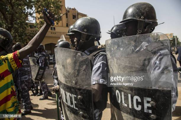 Security forces take keep guard as protesters gathering outside the presidential palace demonstrate against lieutenant general Abdel Fattah...