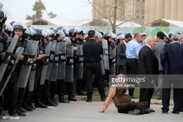 Security forces take measurements as civil servants working for the Iraqi Kurdish Regional Government on 25 March 2018 demonstrate against the...