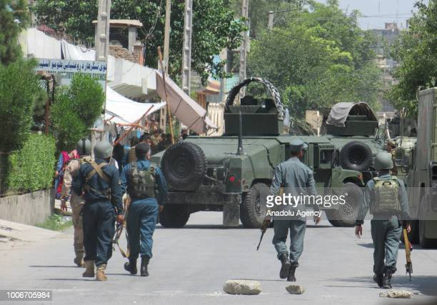 Security forces take measures after a bomb and gun attack near a training center for midwives near the city center of Jalalabad Afghanistan on July...
