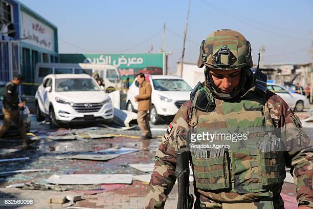 Security forces take measures at the Nahda Bus Station in Baghdad Iraq on January 24 2017 Casualties were reported after the car bomb attack leaving...