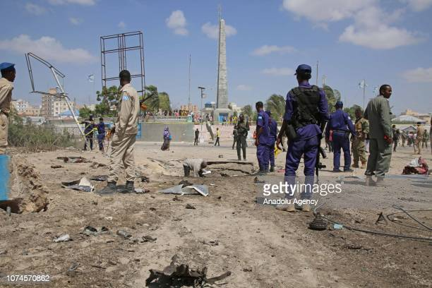 Security forces take security measures after a suicide car bombing targeted a security checkpoint near the presidential palace in Mogadishu Somalia...