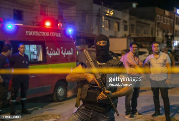 Security forces take security measures after a terrorist blew himself in Al-intilaka neighbourhood, west of the Tunisian capital, after security...