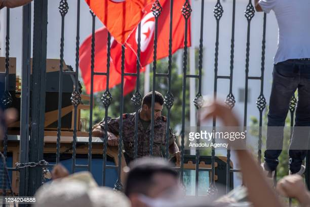 Security forces take security measures around parliament building as supporters and opponents of coup gather in front of parliament building after...