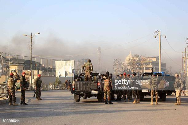 Security forces take security measures around the area after a bomb attack on German consulate general in MazariSharif Afghanistan on November 11...