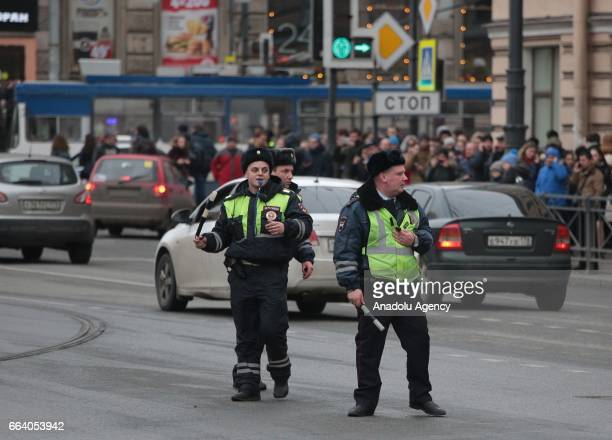 Security forces take security measures around the area after an explosion at a subway station in St Petersburg Russia on April 3 2017 At least 10...