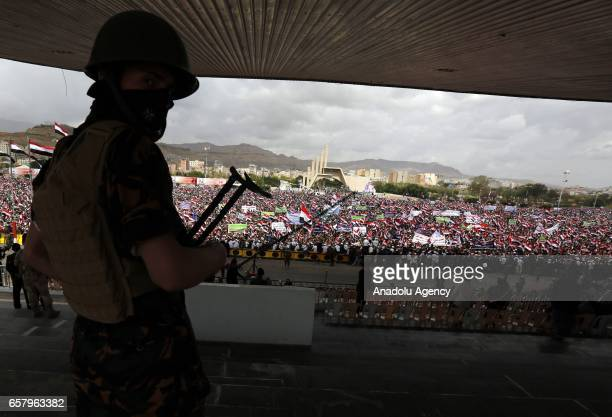 Security forces take security measures as Houthis and supporters of ousted leader Ali Abdullah Saleh gather to protest the Saudiled operations during...
