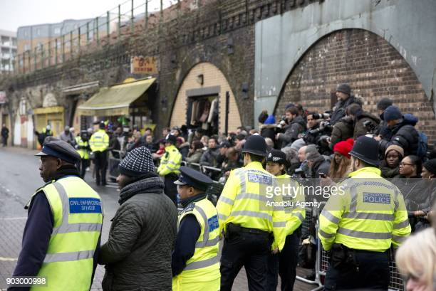 Security forces take security measures as Prince Harry and his fiance Meghan Markle arrive to Pop Brixton to see the broadcaster's work supporting...