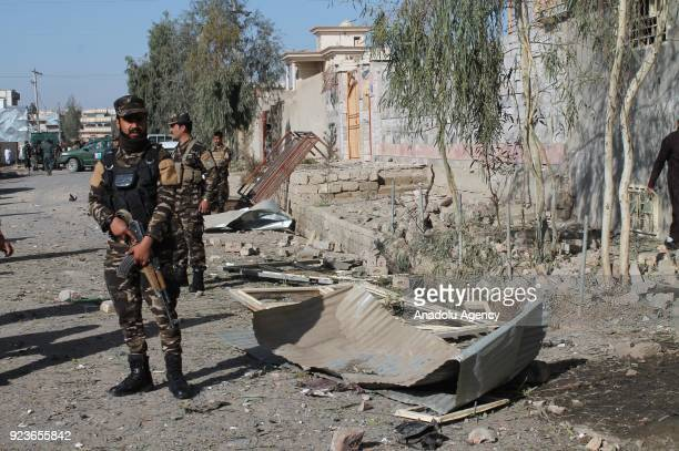 Security forces take security measures at the site after two attacks carried out with bombladen vehicles in Helmand Afghanistan on February 24 2018...