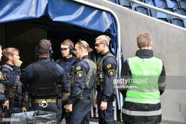 Security forces take security measures during a training session of France ahead of FIFA 2018 World Cup Qualifiers match between Sweden and France at...