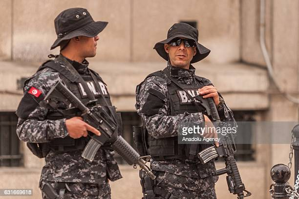 Security forces take security measures during the celebration to mark the sixth anniversary of the Jasmine Revolution at the Avenue Habib Bourguiba...