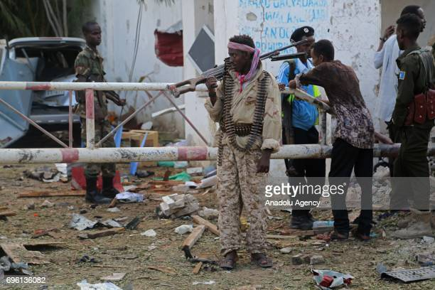 Security forces take security measures near the wreckages at the site after bombladen vehicle attack by AlShabaab militants to a restaurant in...