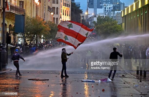 Security forces use water cannon on a protesters as they intervene in a protest against country's economic and political situation in Beirut Lebanon...