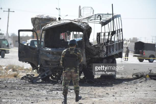 Security forces work at the scene after a blast targeted a truck carrying policemen on the outskirts of Quetta the capital of Balochistan on October...