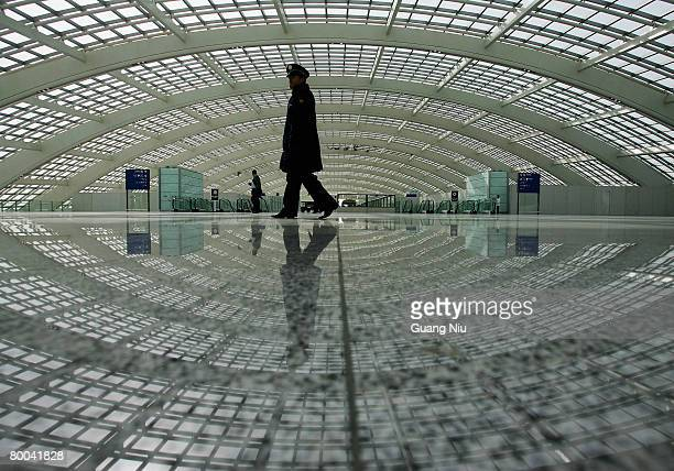 A security gaurd patrols at the new terminal building T3 at the Beijing Capital International Airport on February 28 2008 in Beijing China The...