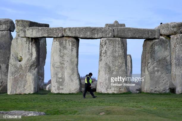 "Security guard at closed Stonehenge on March 20 2020 in Amesbury United Kingdom English Heritage which manages the site said ""Our first priority is..."
