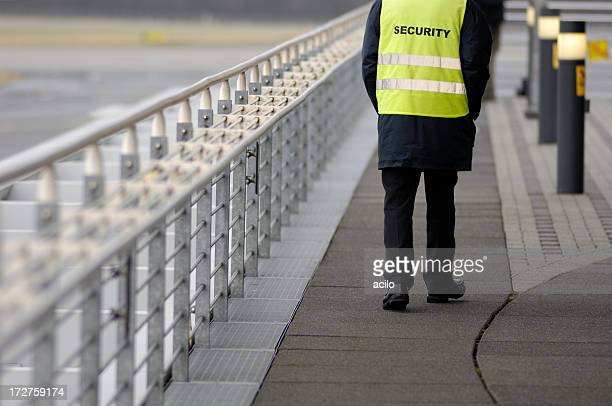 security guard at the airport - watchmen stock pictures, royalty-free photos & images