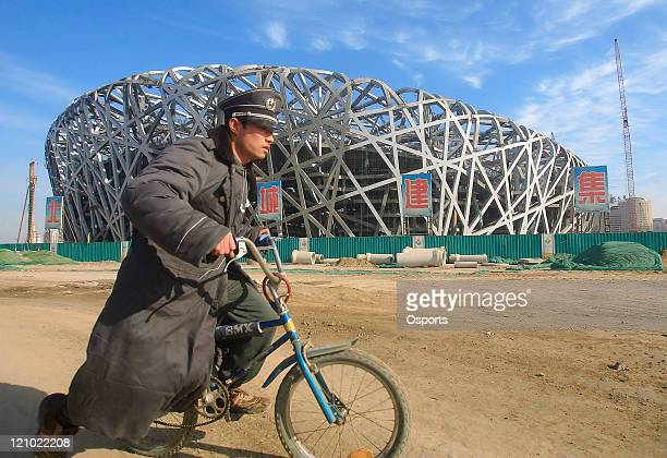 """Security guard at the construction site of the 2008 Olympic Games National Stadium aka """"The Bird's Nest"""" in Beijing, China on December 7, 2006. The..."""
