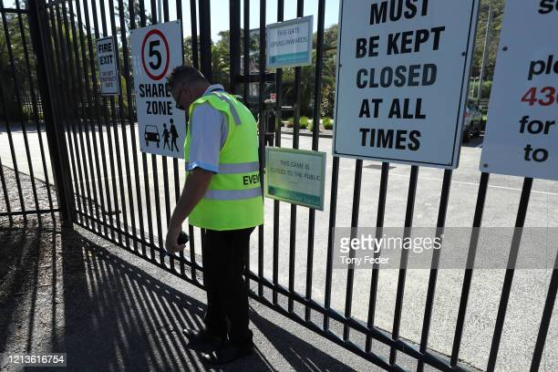 A security guard at the entrance to the stadium during the round 24 ALeague match between the Central Coast Mariners and Melbourne City at Central...