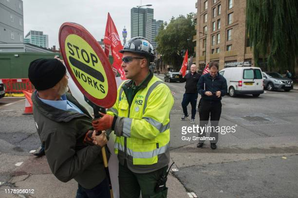 A security guard attempts to retrieve his stop sign from one of the protestors on October 4 2019 in London England Members of the UNITE London and...