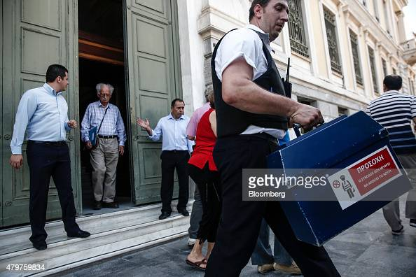 Incredible A Security Guard Carries A Cash Box Out Of A National Bank Of Greece Wiring Cloud Usnesfoxcilixyz