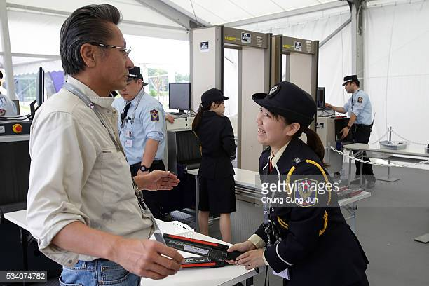Security guard check people at the IMC on May 24 2016 in Shima Japan The G7 summit will be held in Kashikojima Island of Japan on May 26 and 27 2016