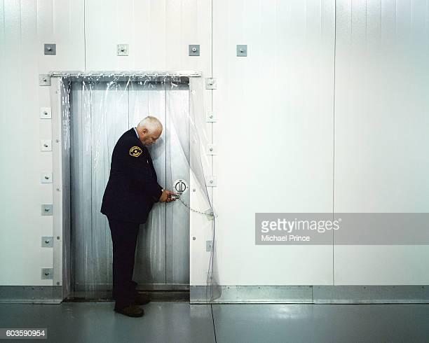 Security Guard Checking Door's Lock