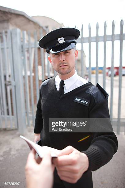 Security guard checking passport