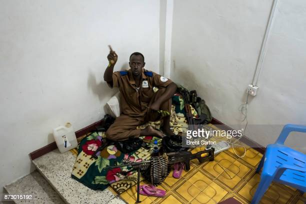 A security guard chews Khat to stay awake in in the stairwell of the Sahafi hotel in Mogadishu All hotels have a heavy security presence in the face...
